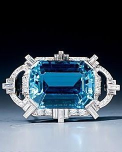 Art Deco aquamarine and diamond plaque brooch, set with a very fine emerald cut aquamarine weighing approx 24 ct, in a baguette cut and round cut diamond surround, mounted in platinum. Circa 1930.