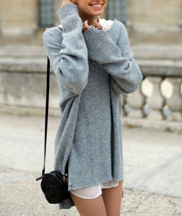 I love oversized sweaters this is perfect. And she has a pretty smile