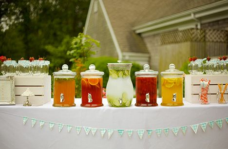 Pretty lemonade bar w/ different flavors in clear servers.
