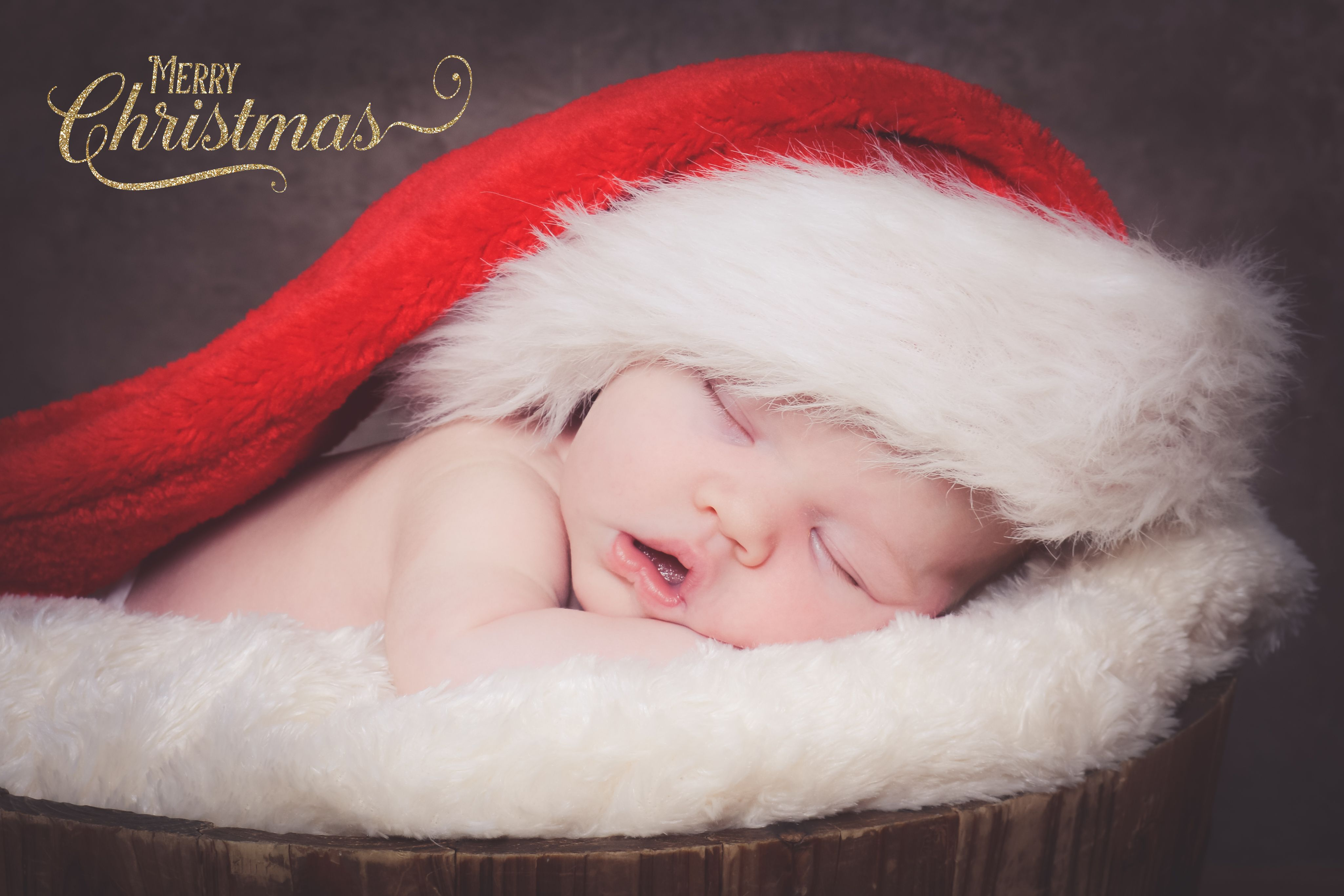 A baby portrait session with an added christams hat newborn photography based in blyth northumberland