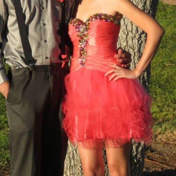 Jeweled pink Prom/ homecoming dress Bright coral/hot pink. Sparkles and big gems. Strapless.  Lace up back.   In PERFECT condition.   I wish I could wear it every day haha.    Other dresses, formal and not, check out my closet!! Will drop price for shipping break. Cinderella Dresses