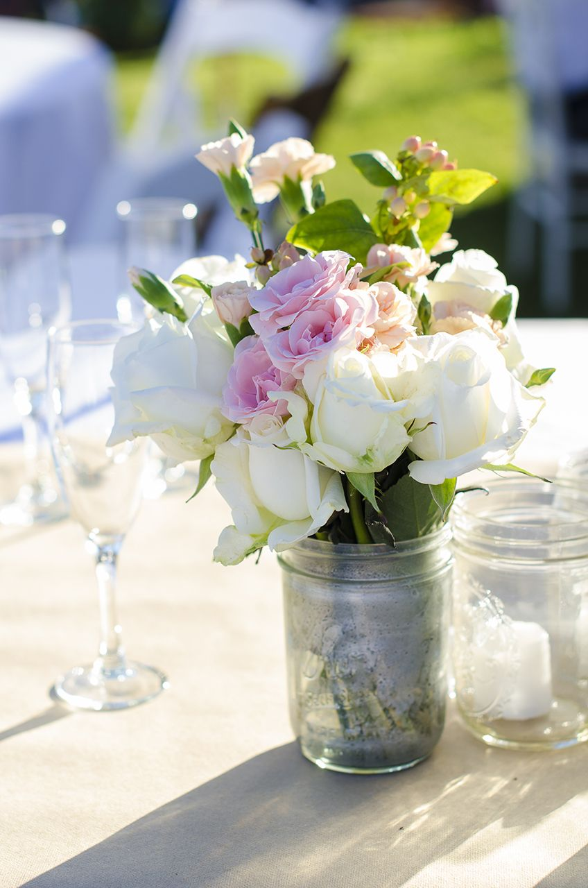 Wedding Reception Table Centerpiece | Pink and white flowers placed in a mason jar | DIY wedding decor | Photo by Photography For A Reason