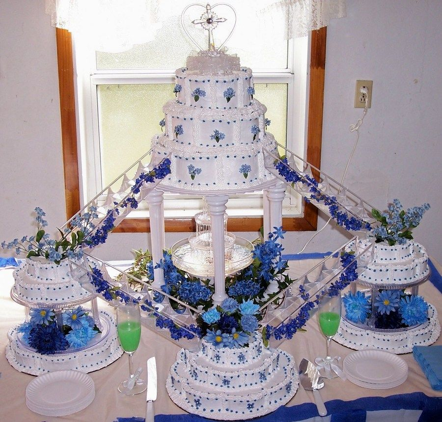 white and blue wedding cake with fountain Fountain