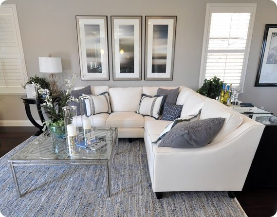 Light gray walls in living room with white couch.