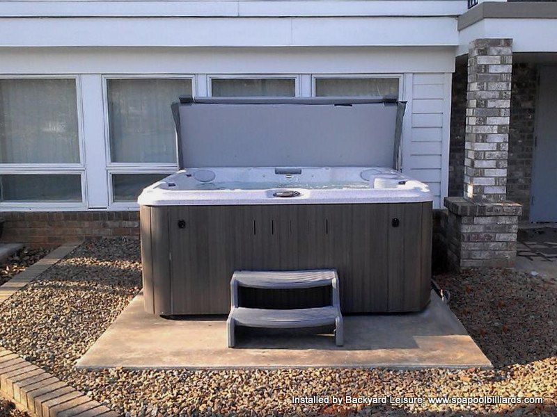 Jacuzzi Hot Tub On Concrete Slab With Steps And Cover