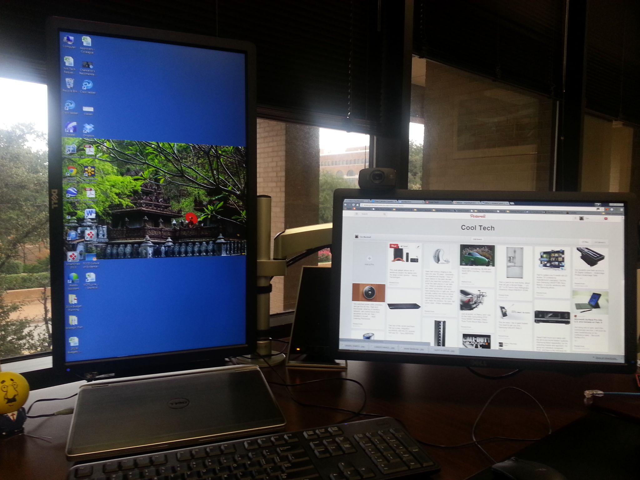 dual monitor setup at work one portrait and one landscape made
