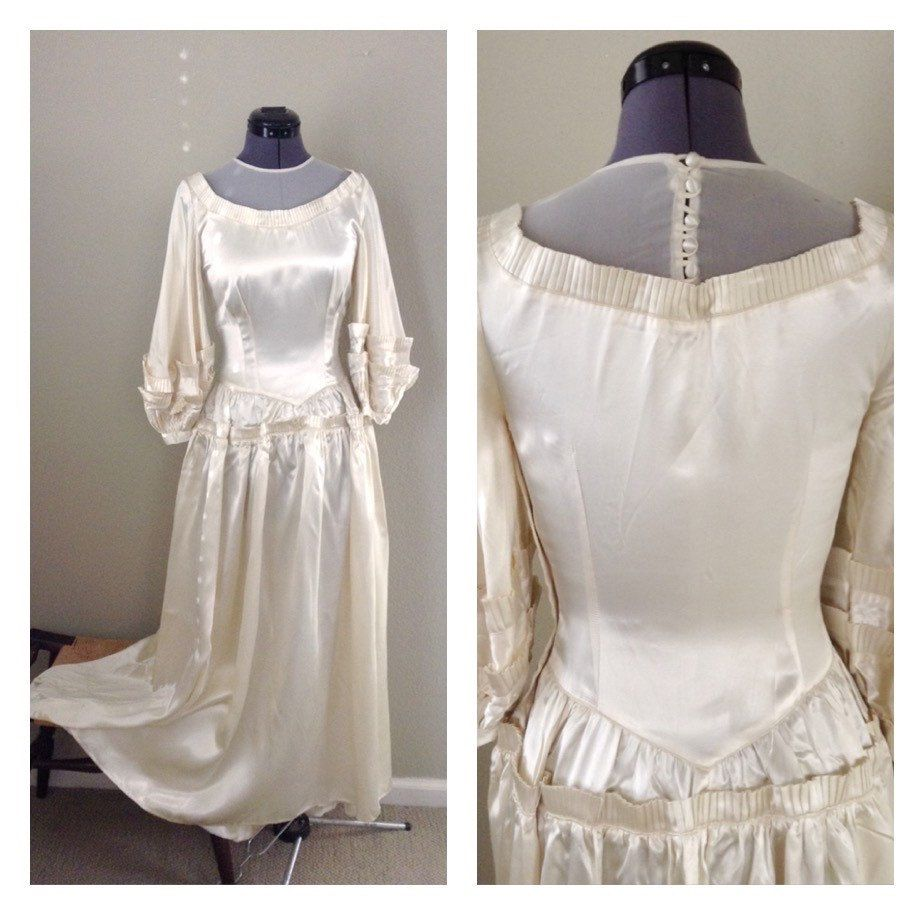A personal favorite from my Etsy shop https://www.etsy.com/listing/268448990/vintage-1940s-liquid-satin-wedding-gown