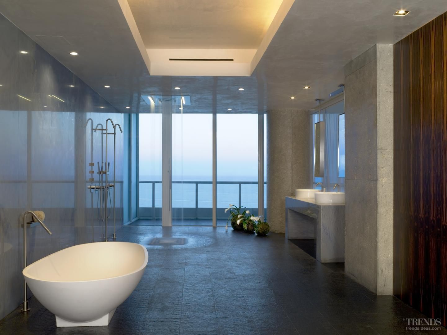 This penthouse bathroom, designed by Sand Studios, features blue ...