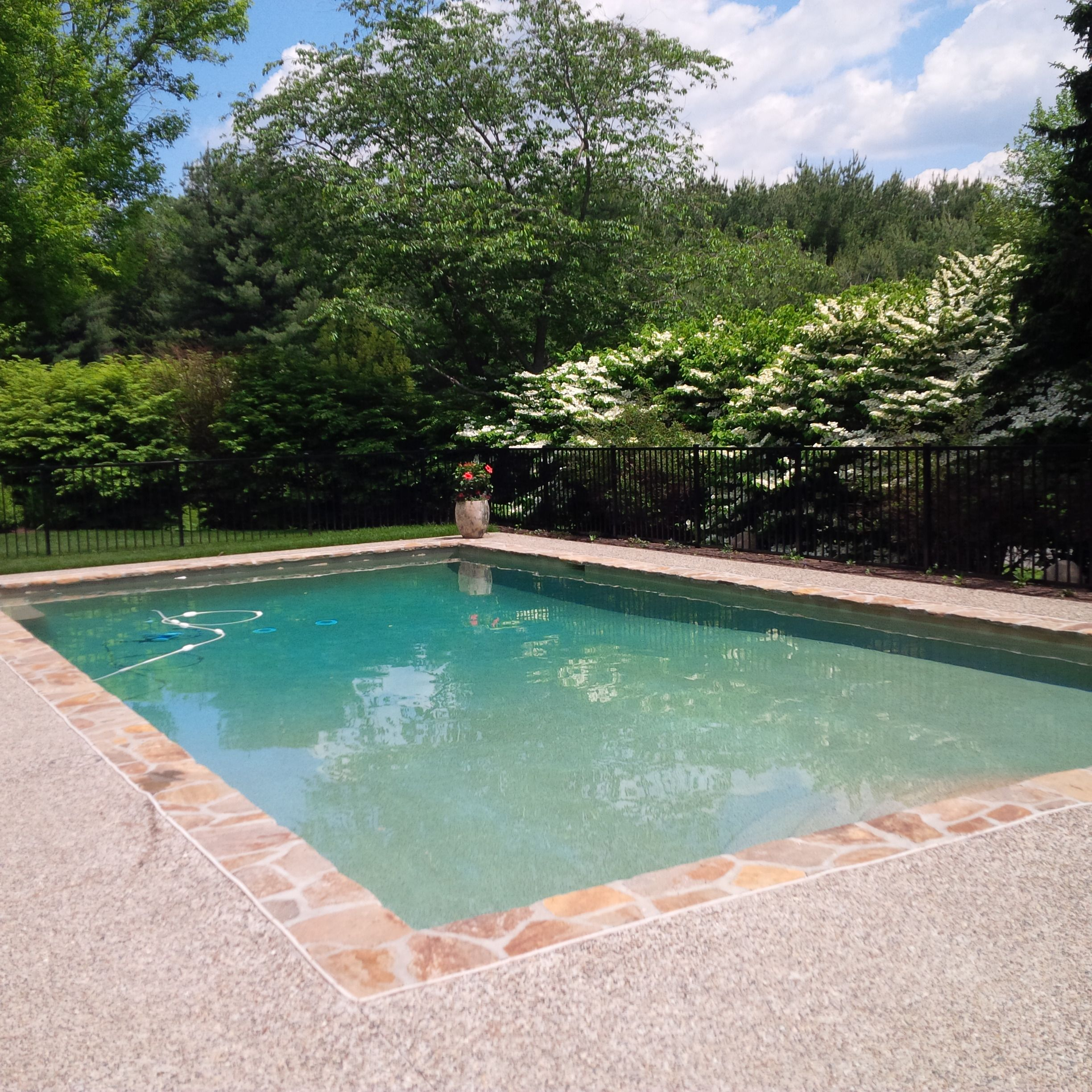 Sealing exposed aggregate pool deck - Chadds Ford Renovated Pool Featuring Stone Coping With Exposed Aggregate Concrete Deck