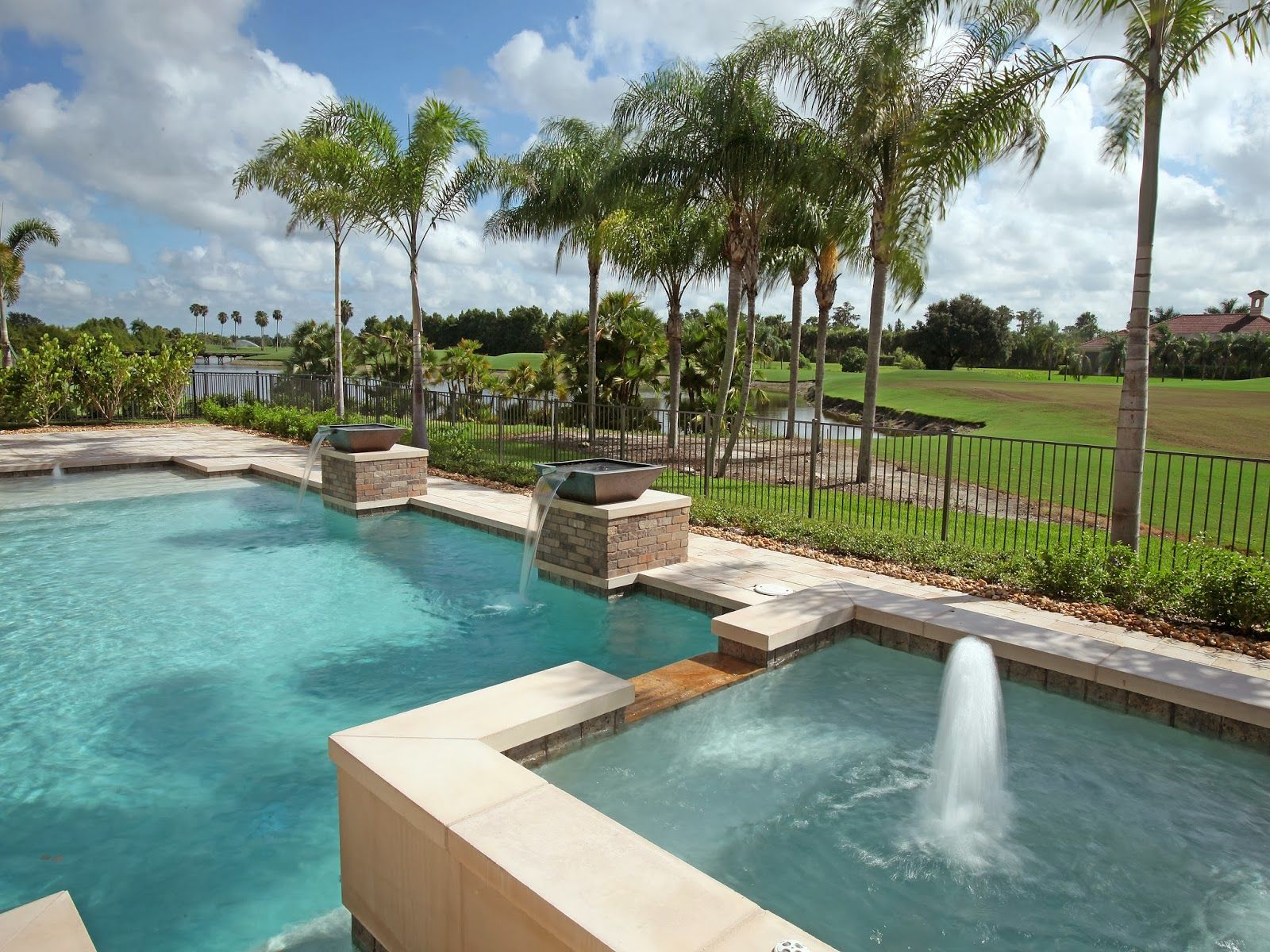 pool and spa with bubbler and fire bowls on the golf course in