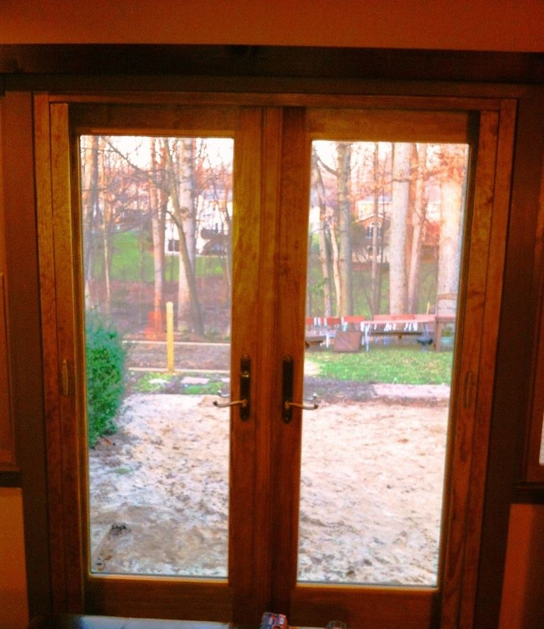 Andersen outswing french door with retractable screen for Outswing french doors