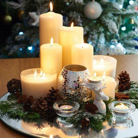 Cream candles arranged on a table | Christmas decoration ideas | Tesco Living
