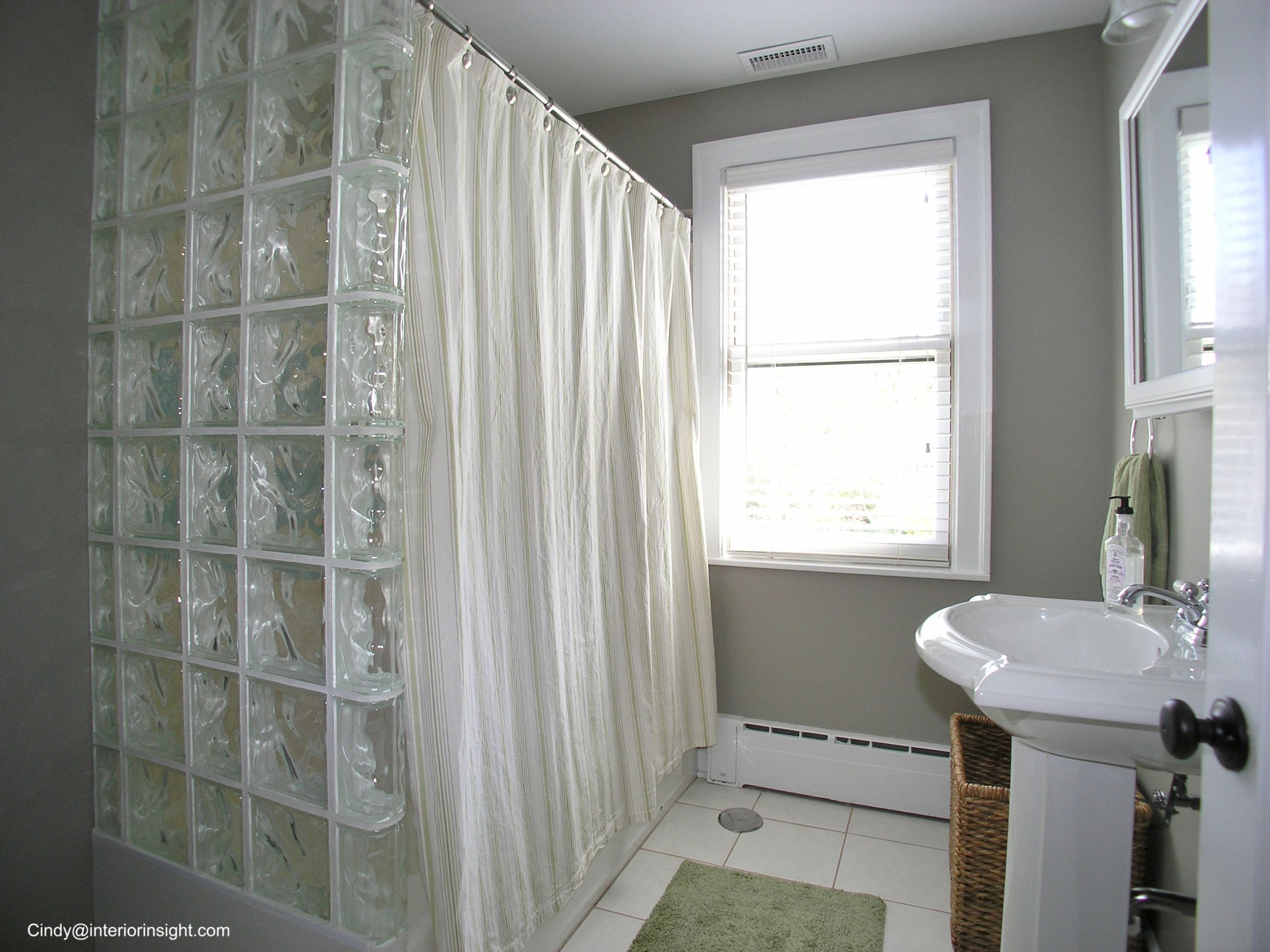 Glass Block in this bathroom tub wall keeps the light coming thru  http://www.tourfactory.com/847549