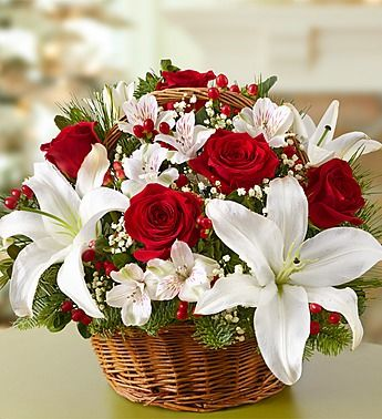 Fields of Europe™ for Christmas Basket  Price:  US$49.99  Inspired by the stylish holiday bouquets found in bustling European flower markets this time of year, our florists designed this gathering of red roses, white lilies, alstroemeria and Christmas greens inside a classic handled basket. Perfect as a holiday centerpiece, hostess gift or for your own décor—no passport necessary.