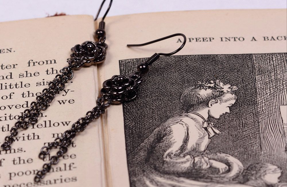 Vampire Diaries Anna Inspired Black Rose Chain Earrings in Gunmetal. $22.00, via Etsy.