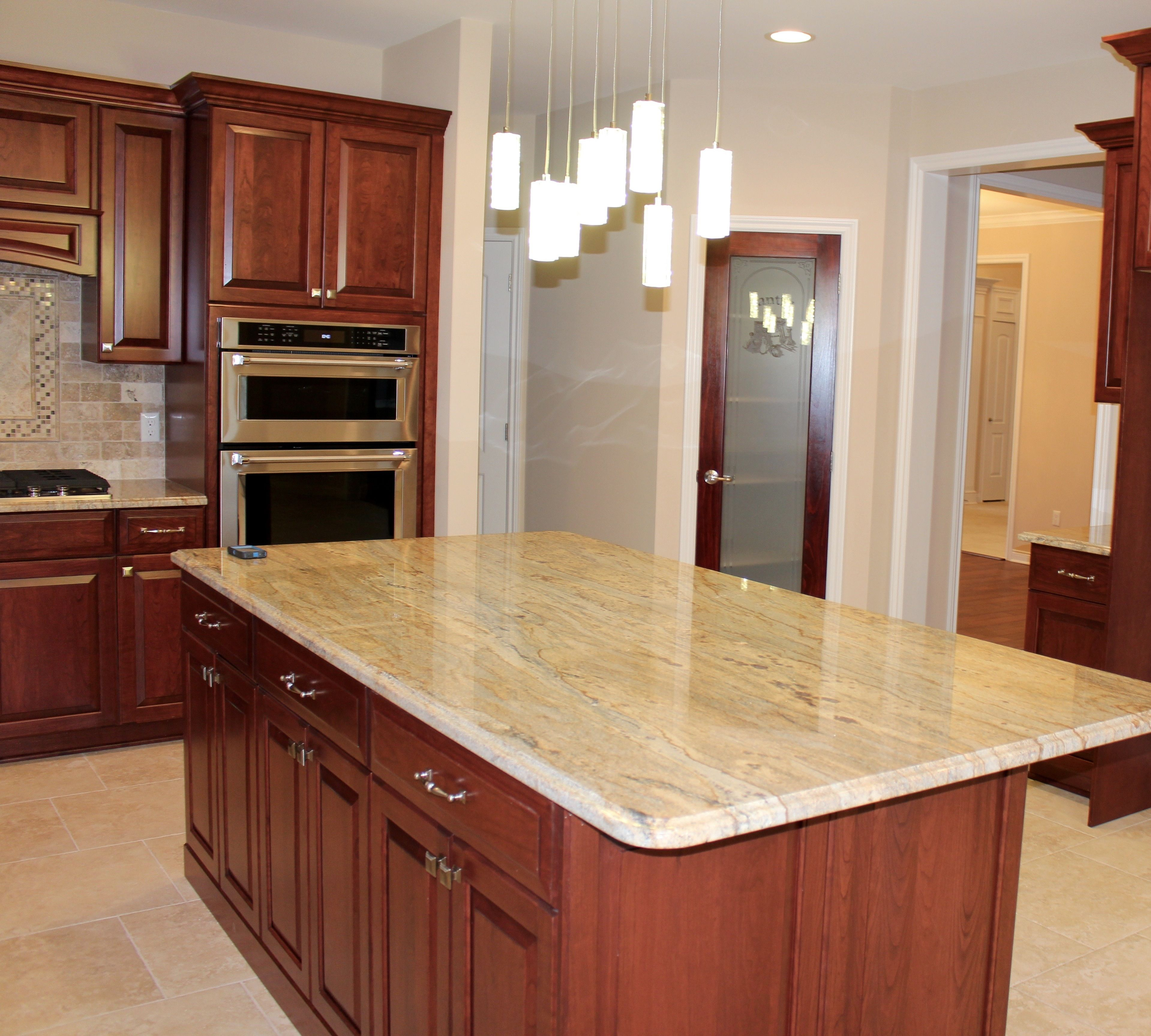 Cabinets By Lafata: Jamestown Style, Cherry Wood, Sienna Finish. Countertops  By Granite USA: Phoenix Gold. Paint By Colorsplash: Sand Dollar.
