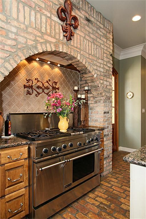 The Oven Is Accented With An Arched Wall Built With Old