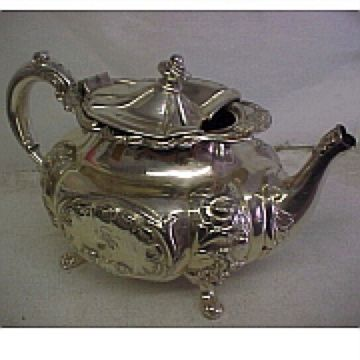 damaged Victorian silver plated teapot