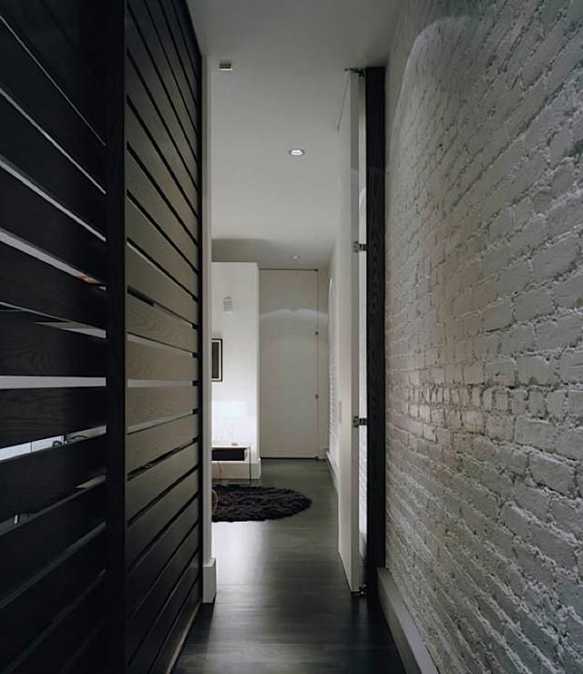 Painted exposed brick - glossy white - reflect light