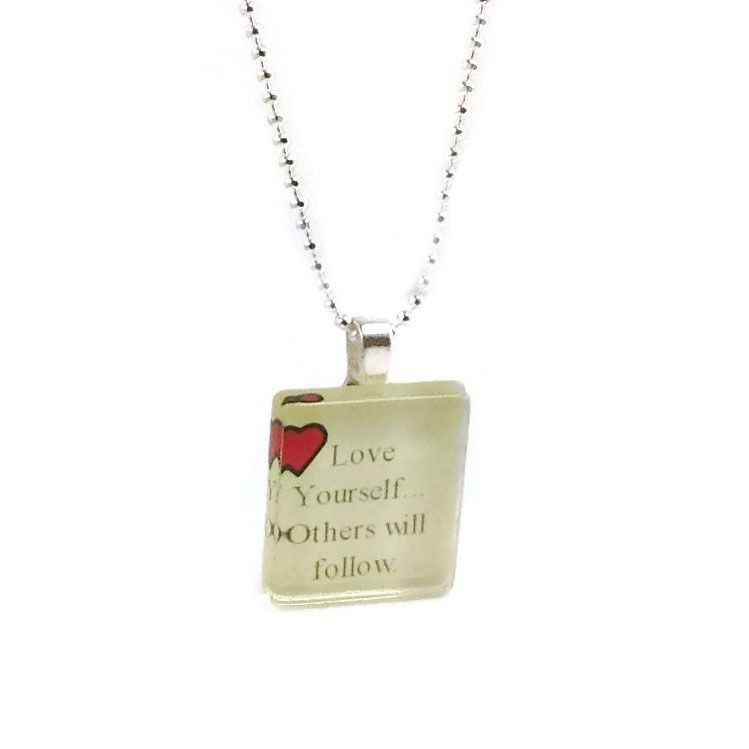 An inspiring glass pendant necklace 'Love yourself and others will follow', a saying that is so true in nature.