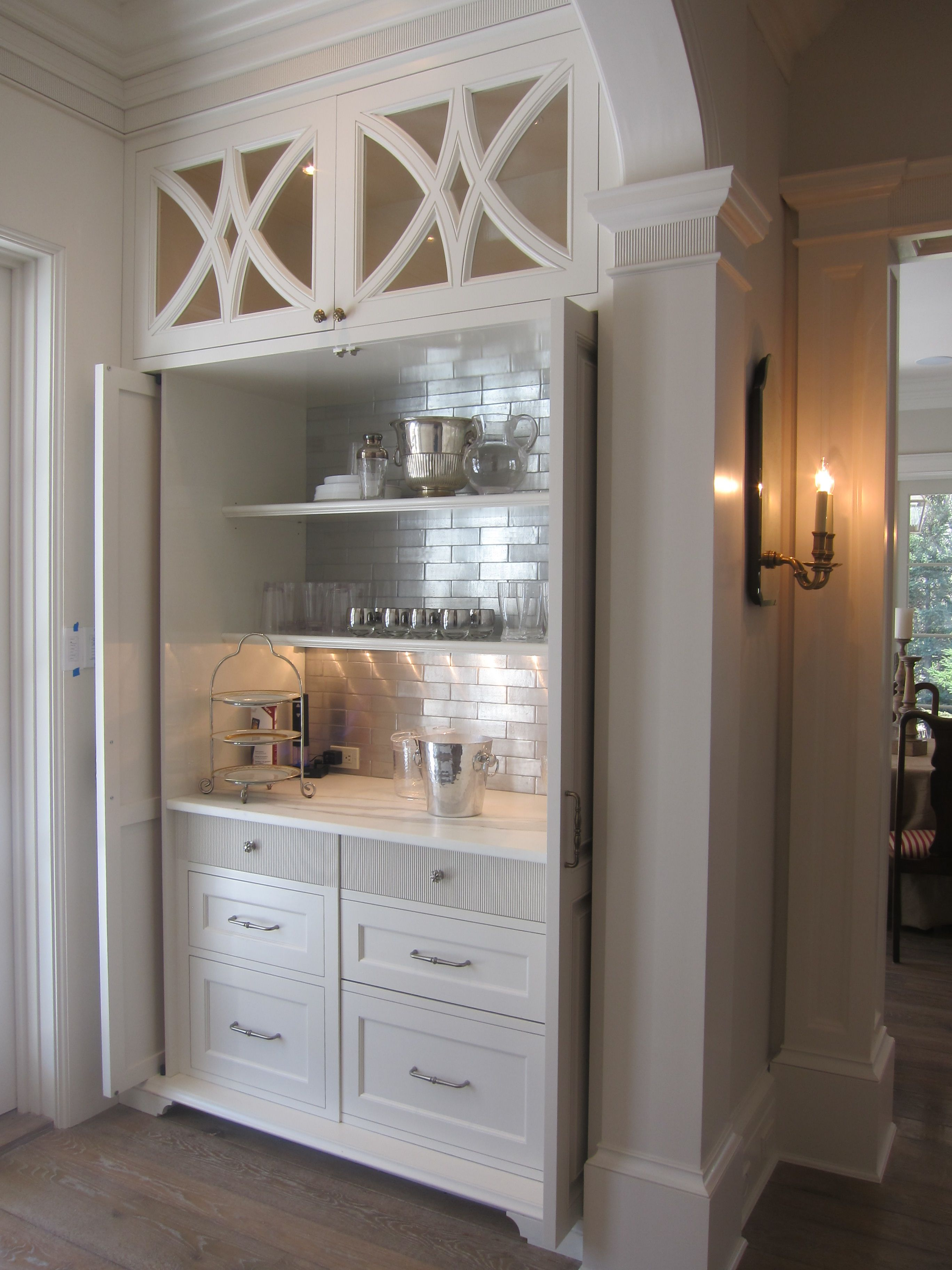 Beautiful Custom Dry Bar Area With Recessed Pocket Doors Inset Shaker Style Drawers And