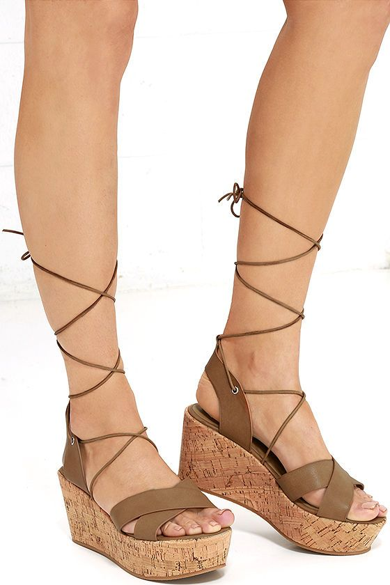 298a58fe2e30 Longing for the perfect pair of sandals for the season  Say hello to the  Lovely Luster Tan Lace-Up Platform Wedges! Tan vegan leather crosses over a  ...