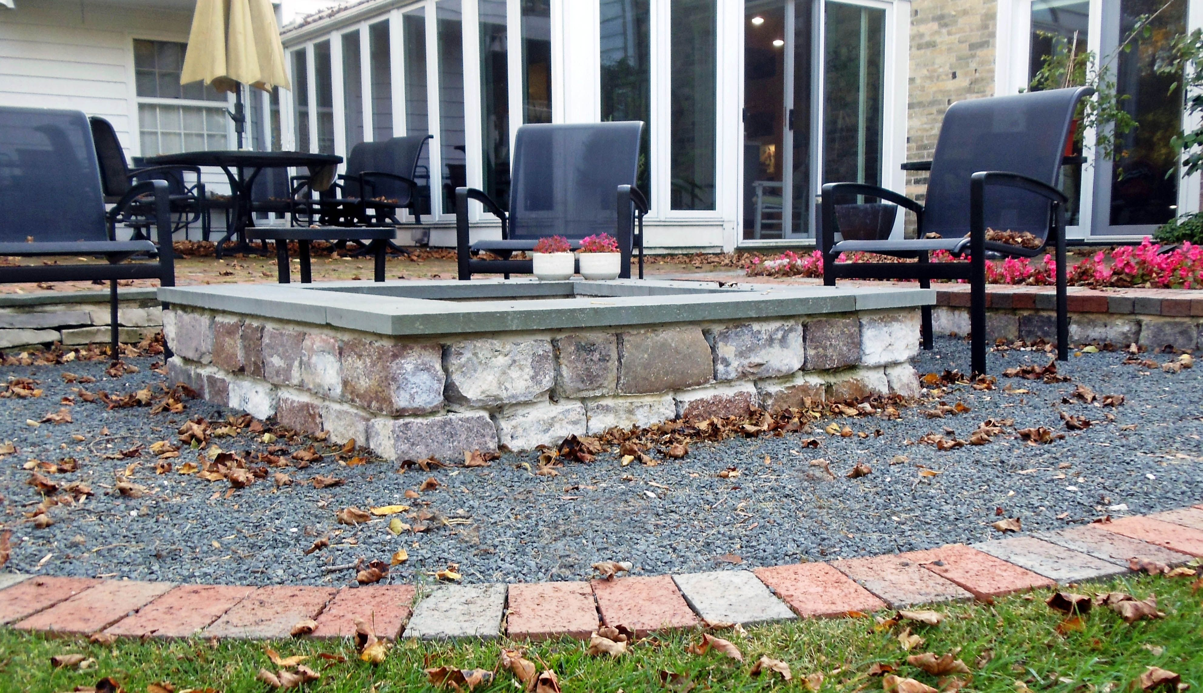 Cobble and Bluestone natural outdoor fireplace