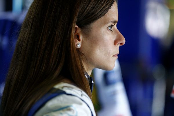 Danica Patrick Photos - Danica Patrick, driver of the #10 Aspen Dental Chevrolet, stands in the garage area during practice for the NASCAR Sprint Cup Series GEICO 500 at Talladega Superspeedway on April 29, 2016 in Talladega, Alabama. - Talladega Superspeedway - Day 1