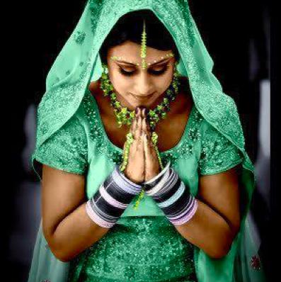 Praying Indian Beauty in green.