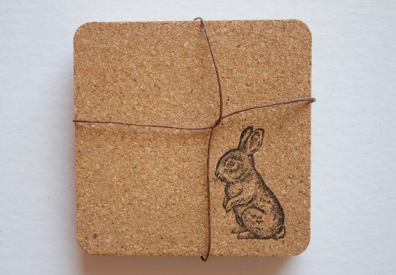 These square cork coasters have rounded corners and are hand printed with a rabbit on one side. Because of the handmade nature of these coasters