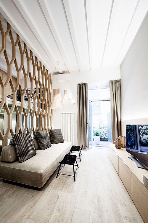 A Dividing Wall Is Used To Separate Rooms In This Beautiful