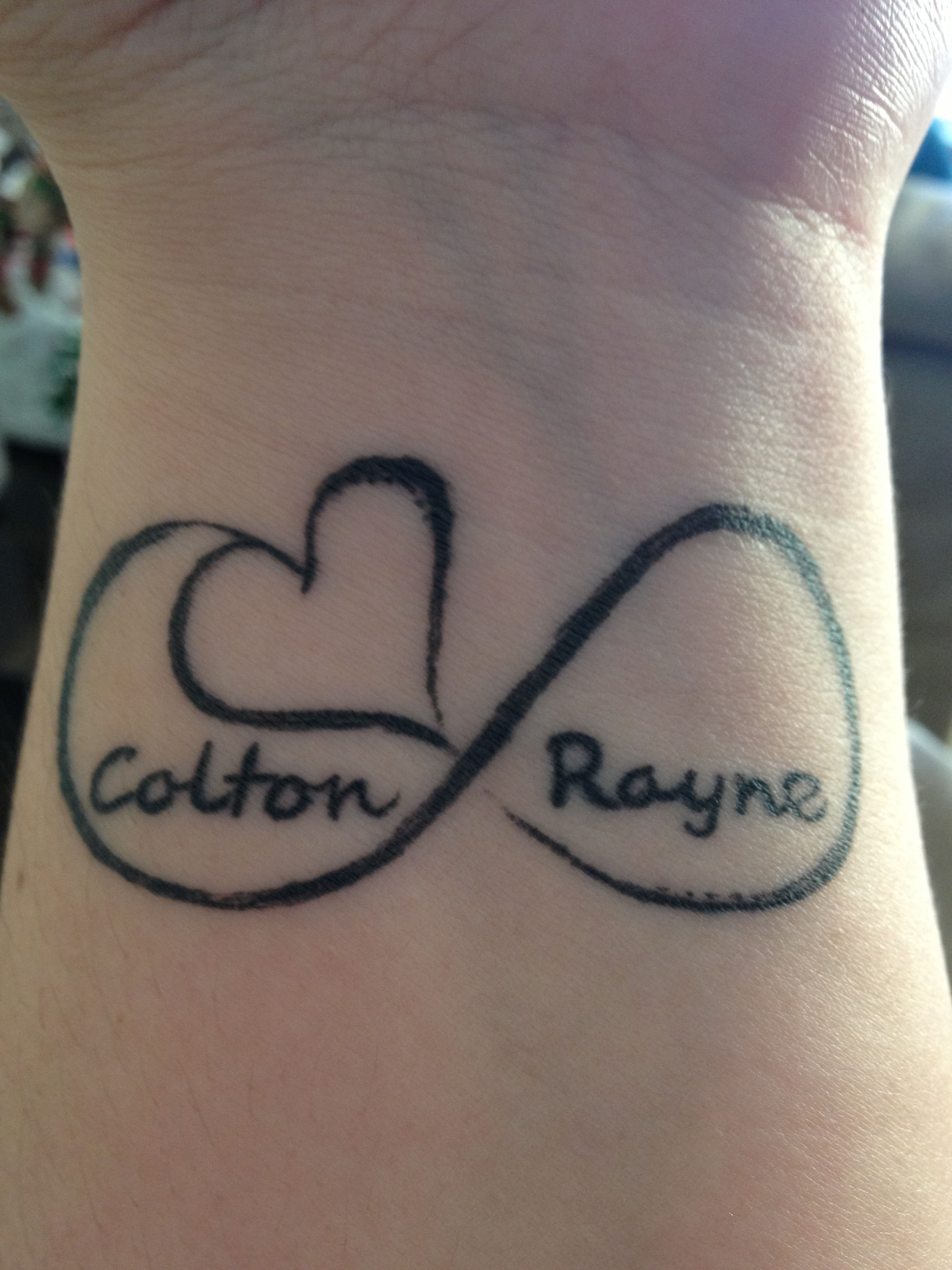 Wrist tattoo i so want this with alexis and saraus name on my wrist