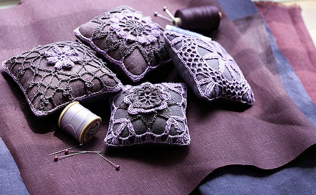 Pin cushions in purple by namolio, via Flickr