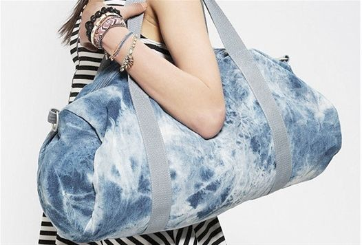 BDG acid wash denim overnighter bag