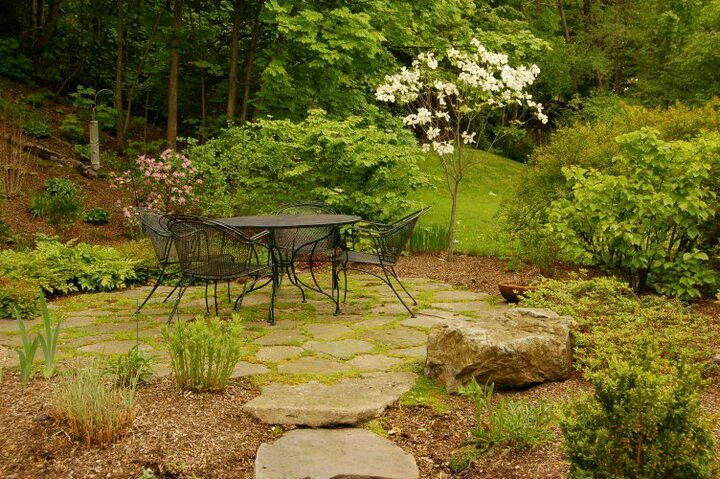 Fieldstone path and patio interplanted with moss ...