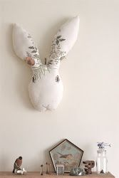 a wooden tree: Big bunnies to hang on a wall. Fun idea! (photo only)