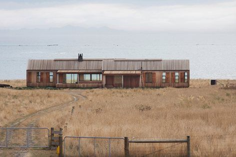 This is a robust structure, designed to form the centre piece of a remote, symmetrical and thundering surf beach. It is sited on one of New Zealand's iconic coastal sheep and cattle stations and is intended as a farm experience for family...