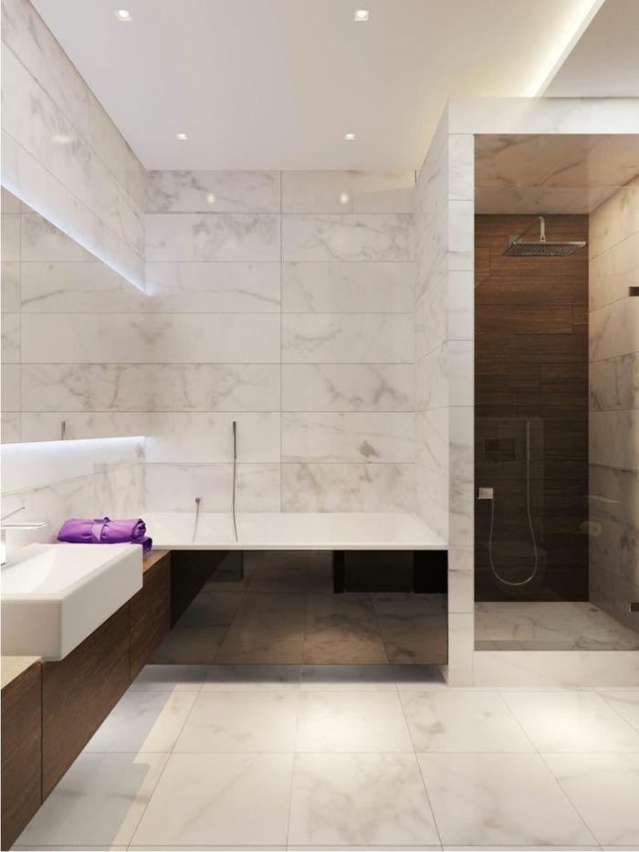 jolie salle de bain en marbre blanc et luminaire led
