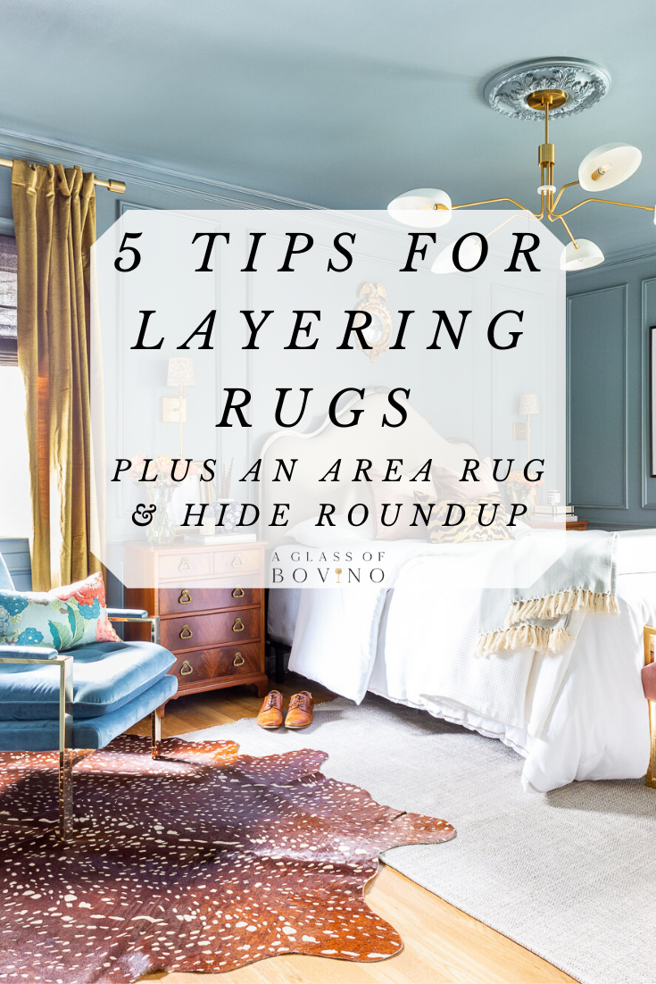 5 Tips For Layering Rugs Plus An Area Rug Hide Roundup Layered Rugs Layered Rugs Living Room Layered Rugs Bedroom