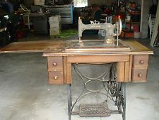 ANTIQUE NEW HOME TREADLE SEWING MACHINE IN WOOD CABINET 4 DRAWERS ...