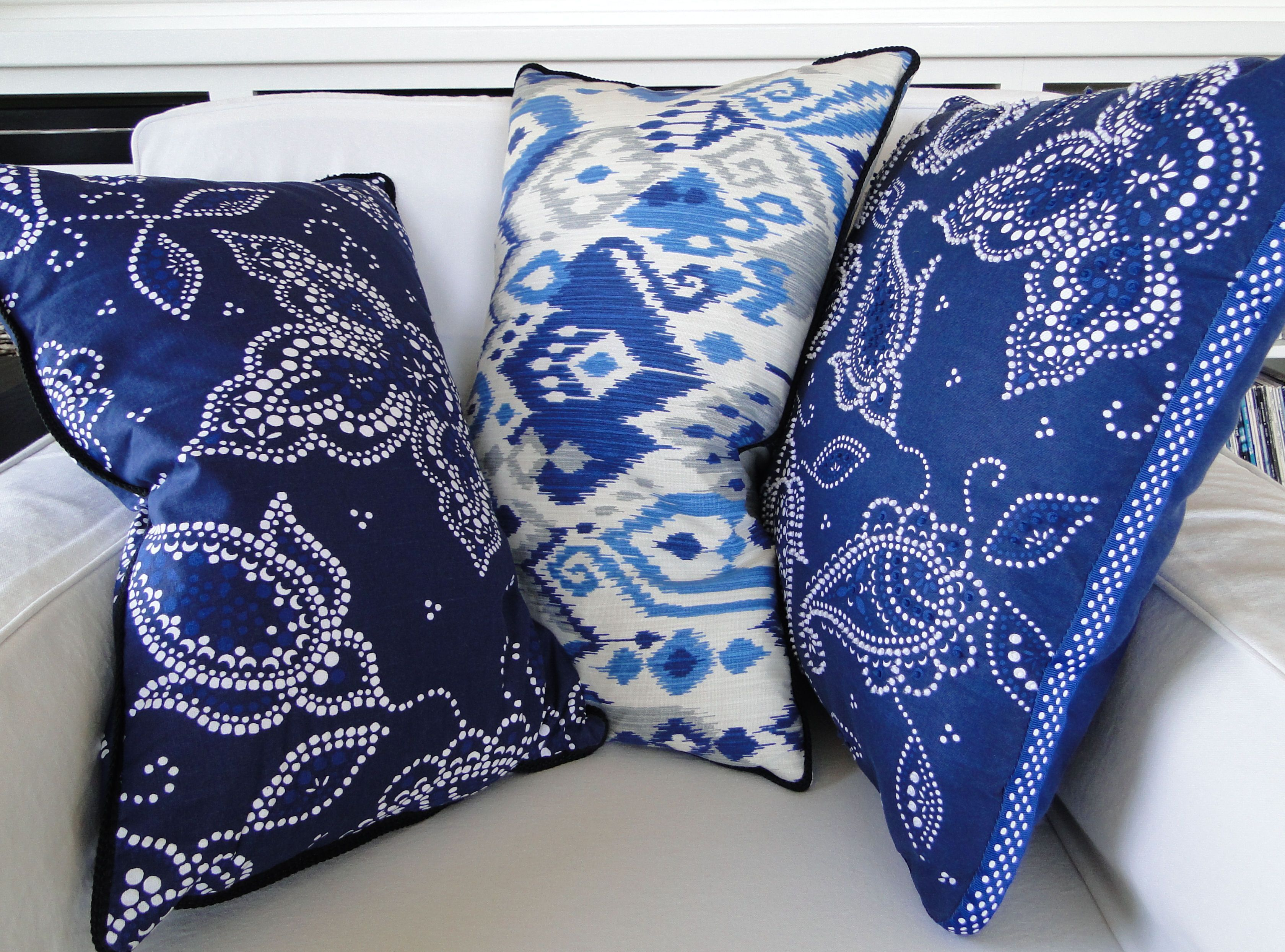 50 Decorating Ideas to Live By: 11. Seasonal Decorating Makeover. For pillows, the perfect blue&white fabrics were found - in shower curtains! Yep, 100% cotton shower curtains. Bed, Bath & Beyond had this IKAT print, Target the Indian paisley. They also had 20 pillows in the same fabric. Those got dolled up with polka dot ribbon sewn around the seam lines for a bit more custom look. Read more at www.decorbook.com #indianbeddoll 50 Decorating Ideas to Live By: 11. Seasonal Decorating Makeover. F #indianbeddoll