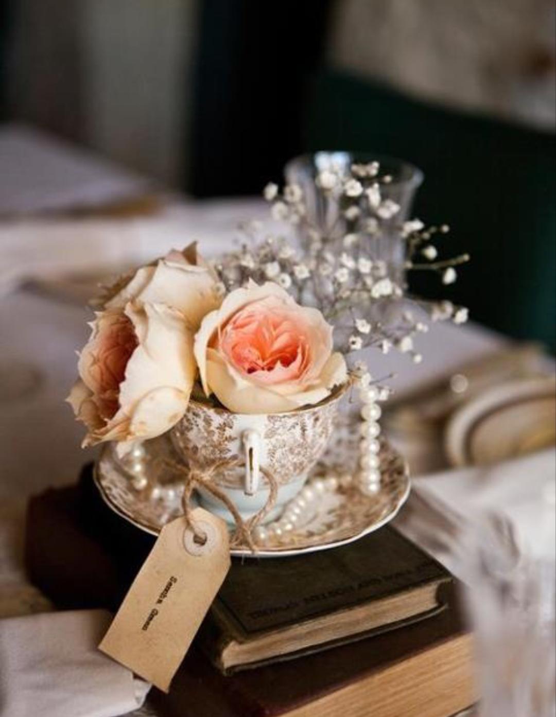 wedding reception decor roses tea cups old books pearls rh pinterest com