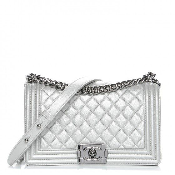 This is an authentic CHANEL Metallic Caviar Quilted Medium Boy Flap in  Silver. This stylish 273244eed