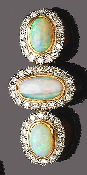 An opal and diamond brooch. The brooch set with three cabochon opals, each within a single-cut diamond surround.