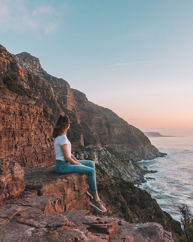 Looking for the most Instagrammable places in Cape Town? This ultimate guide to Cape Town's most beautiful destinations has you covered! Spend a beach day with penguins, watch the sunset from on top of Table Mountain, hike Lions Head, explore a shipwreck and take a photo at the infamous Surfboard Rock! Here are some of the best things to do in Cape Town to add to your Instagram itinerary! #capetown #southafrica #traveltips #instagram #travelguide #travel