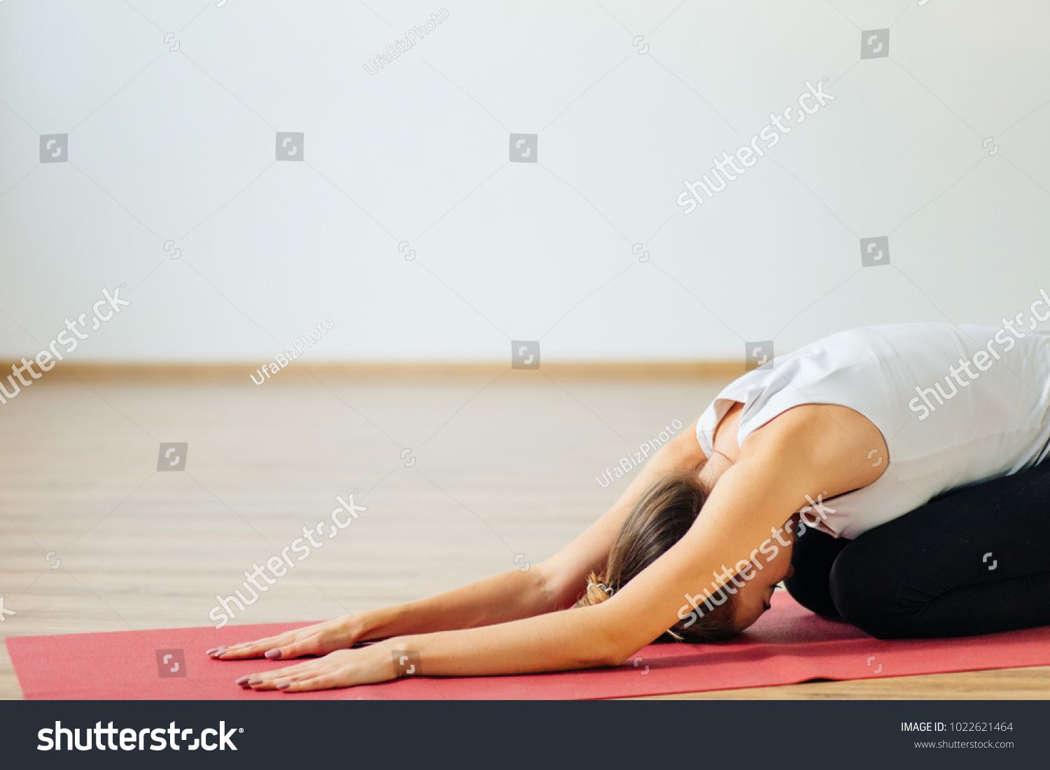 Woman Doing The Child S Pose On Red Yoga Mat Balasana Ad Ad Pose Child Woman Red In 2020 Sport Hall Kid Poses Photo Editing