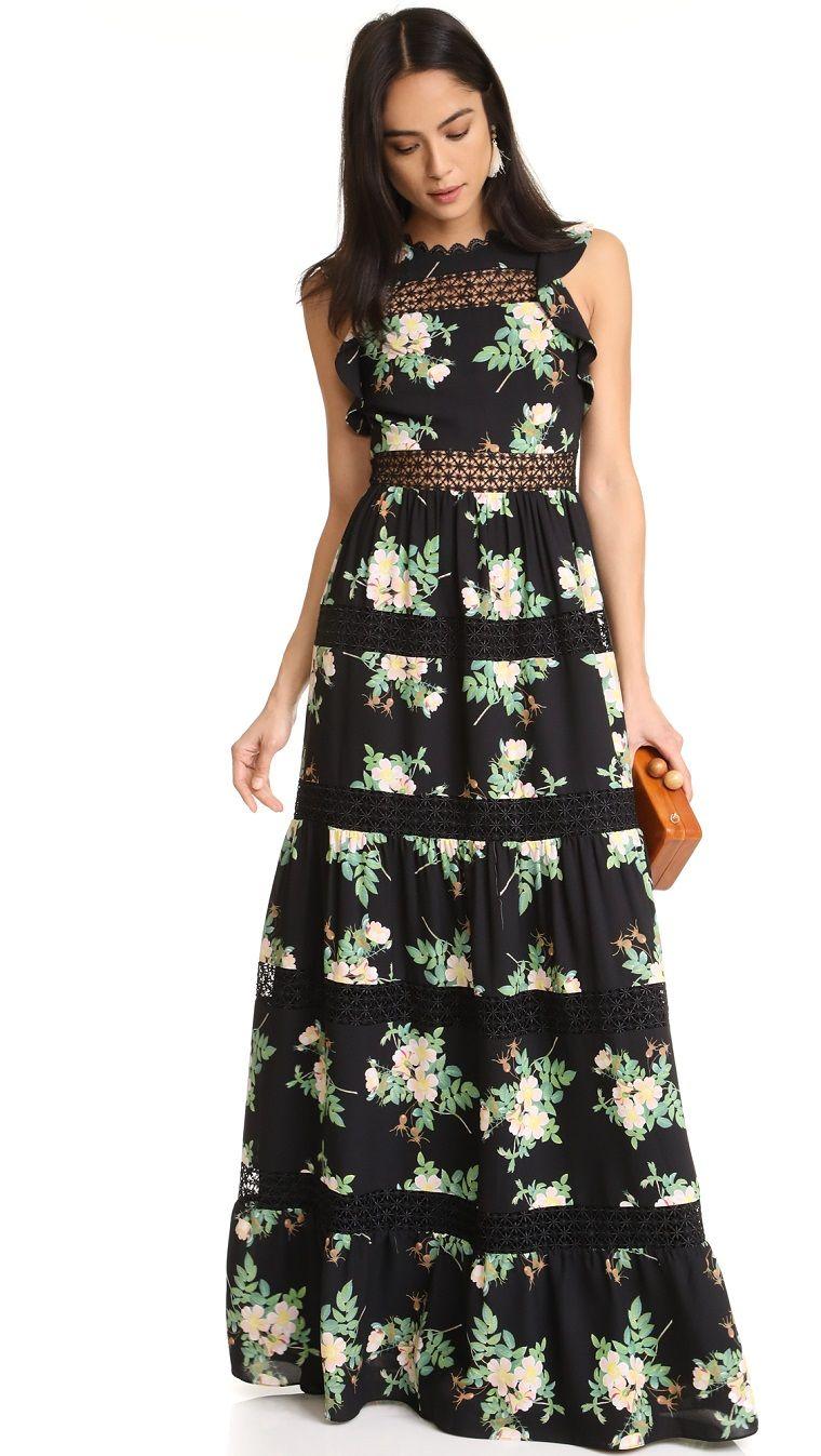 buy online ab935 86748 Abiti da sera lunghi firmati, un vestito con stampe floreali ...
