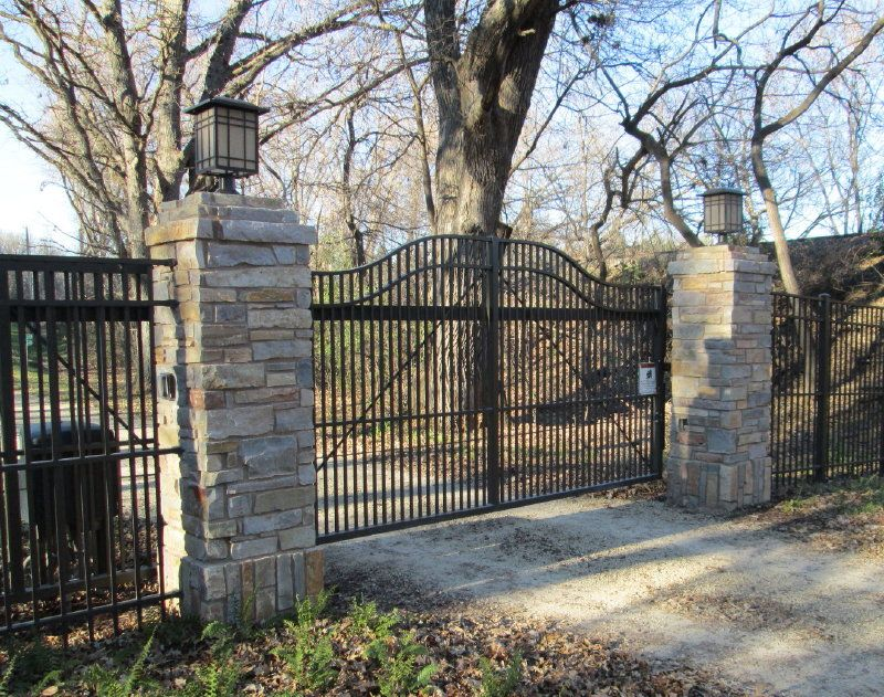 Stone Gate Pillars : Stone pillars with metal gate and fence landscapes ideas