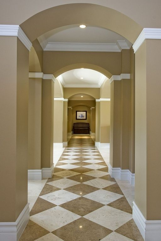 Contemporary Hallway with Crown molding, simple marble