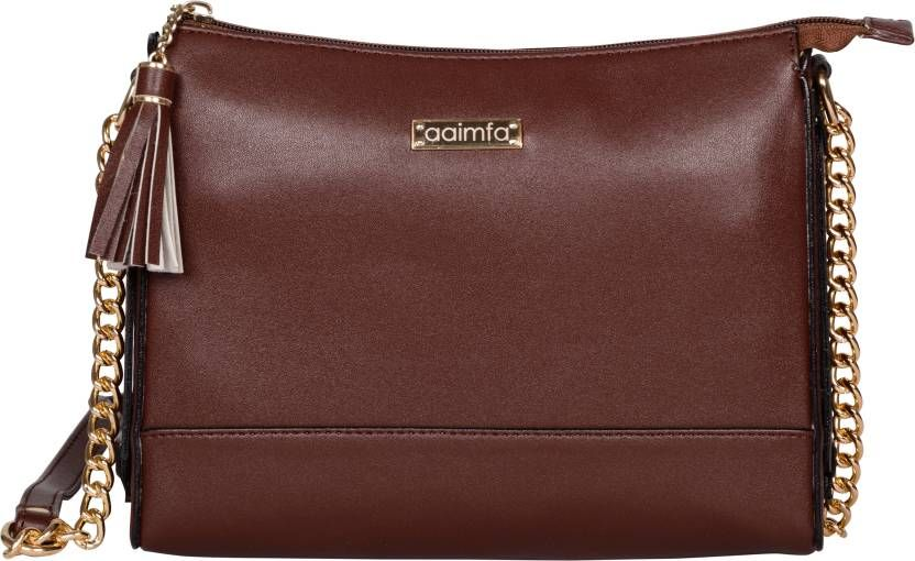 220b1cba2dd7 Score high on the scale of fashion by carrying this beautifully designed sling  bag from aaimfa